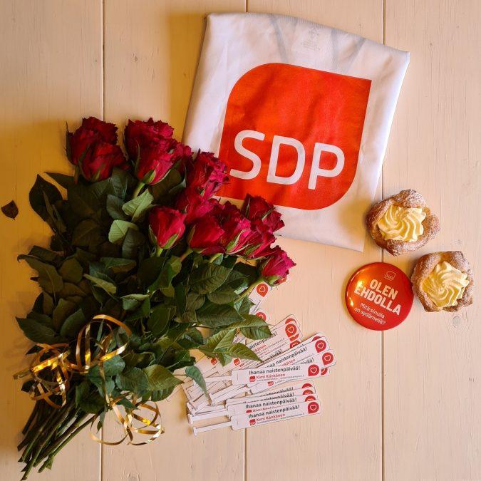 Kuvituskuva, miss äruusuja ja SDP logo